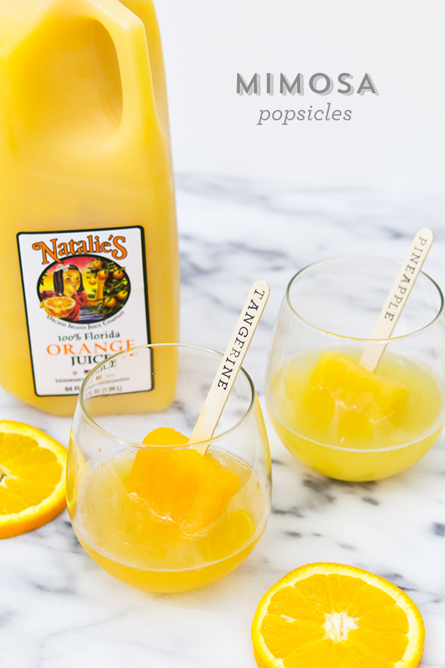 Can't wait to serve up this frozen version of mimosas next time we do brunch! Love the stamped popsicle sticks too!